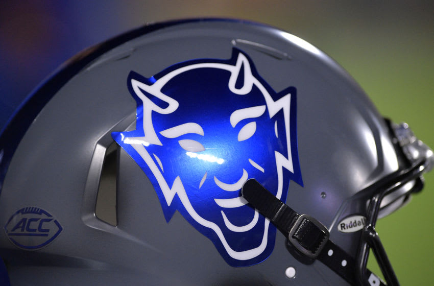 A Duke football helmet on the sidelines prior to a game. (Photo by Lance King/Getty Images)