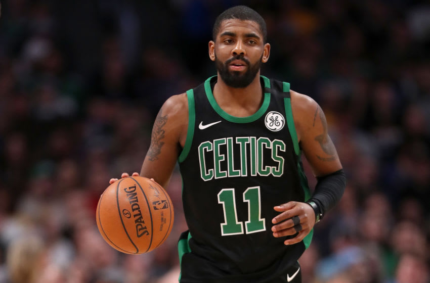 DENVER, CO - JANUARY 29: Kyrie Irving #11 of the Boston Celtics brings the ball down the court against the Denver Nuggets at the Pepsi Center on January 29, 2018 in Denver, Colorado. NOTE TO USER: User expressly acknowledges and agrees that, by downloading and or using this photograph, User is consenting to the terms and conditions of the Getty Images License Agreement. (Photo by Matthew Stockman/Getty Images)