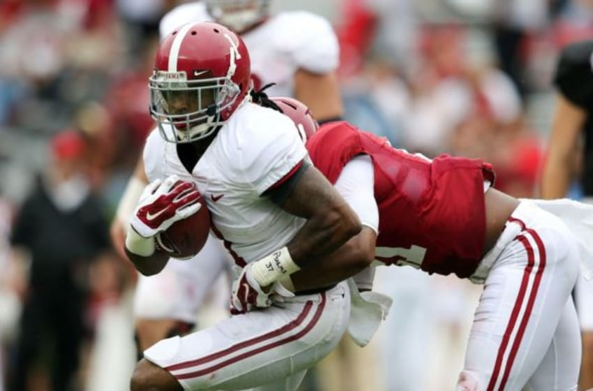 Apr 18, 2015; Tuscaloosa, AL, USA; Alabama Crimson Tide wide receiver Chris Black (1) carries the ball for the white team as Alabama Crimson Tide defensive back Maurice Smith (21) of the crimson team grabs him during the annual A-day game at Bryant Denny Stadium. Mandatory Credit: Marvin Gentry-USA TODAY Sports