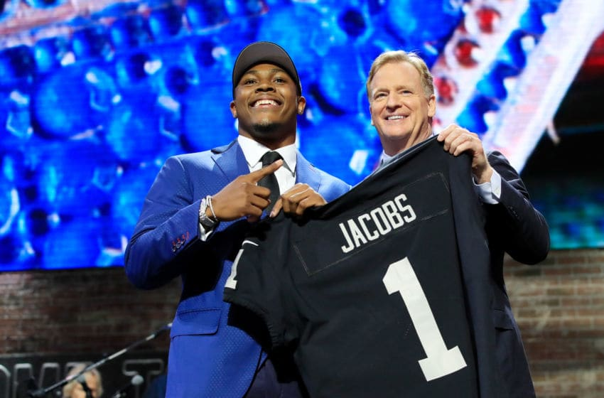 NASHVILLE, TENNESSEE - APRIL 25: Josh Jacobs of Alabama poses with NFL Commissioner Roger Goodell after being chosen #24 overall by the Oakland Raiders during the first round of the 2019 NFL Draft on April 25, 2019 in Nashville, Tennessee. (Photo by Andy Lyons/Getty Images)
