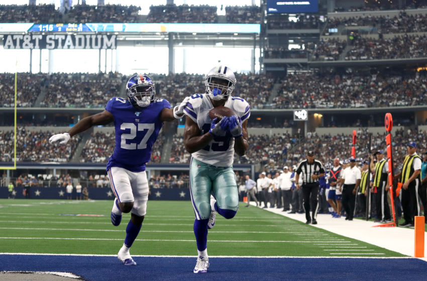 ARLINGTON, TEXAS - SEPTEMBER 08: Wide receiver Amari Cooper #19 of the Dallas Cowboys makes the recption for a touchdown in front of cornerback Deandre Baker #27 of the New York Giants during the second quarter of the game at AT&T Stadium on September 08, 2019 in Arlington, Texas. (Photo by Ronald Martinez/Getty Images)