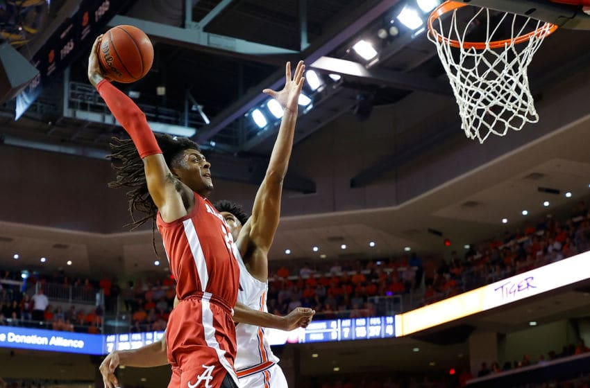 AUBURN, ALABAMA - FEBRUARY 12: John Petty Jr. #23 of the Alabama Crimson Tide dunks against Allen Flanigan #22 of the Auburn Tigers in the first half at Auburn Arena on February 12, 2020 in Auburn, Alabama. (Photo by Kevin C. Cox/Getty Images)