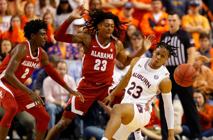 AUBURN, ALABAMA - FEBRUARY 12: Isaac Okoro #23 of the Auburn Tigers loses the ball as he drives against Kira Lewis Jr. #2 of the Alabama Crimson Tide in the first half at Auburn Arena on February 12, 2020 in Auburn, Alabama. (Photo by Kevin C. Cox/Getty Images)