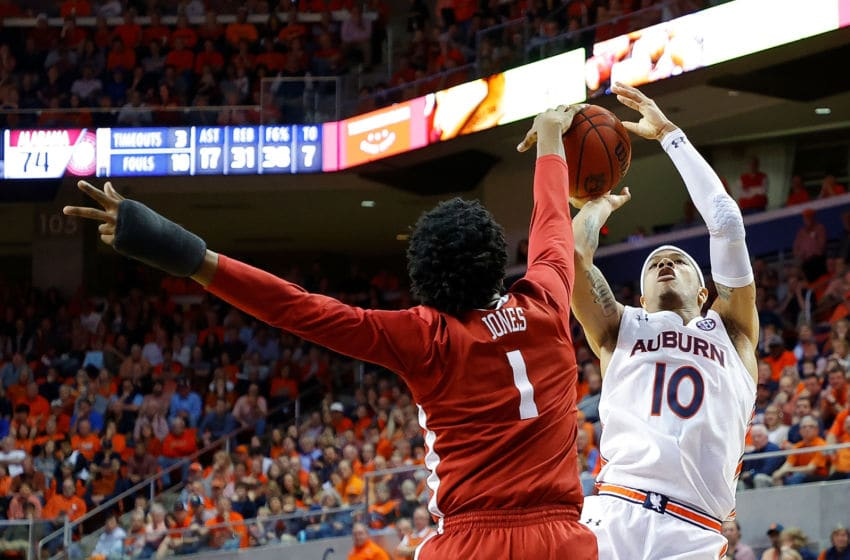 AUBURN, ALABAMA - FEBRUARY 12: Samir Doughty #10 of the Auburn Tigers has his shot blocked by Herbert Jones #1 of the Alabama Crimson Tide in the second half at Auburn Arena on February 12, 2020 in Auburn, Alabama. (Photo by Kevin C. Cox/Getty Images)
