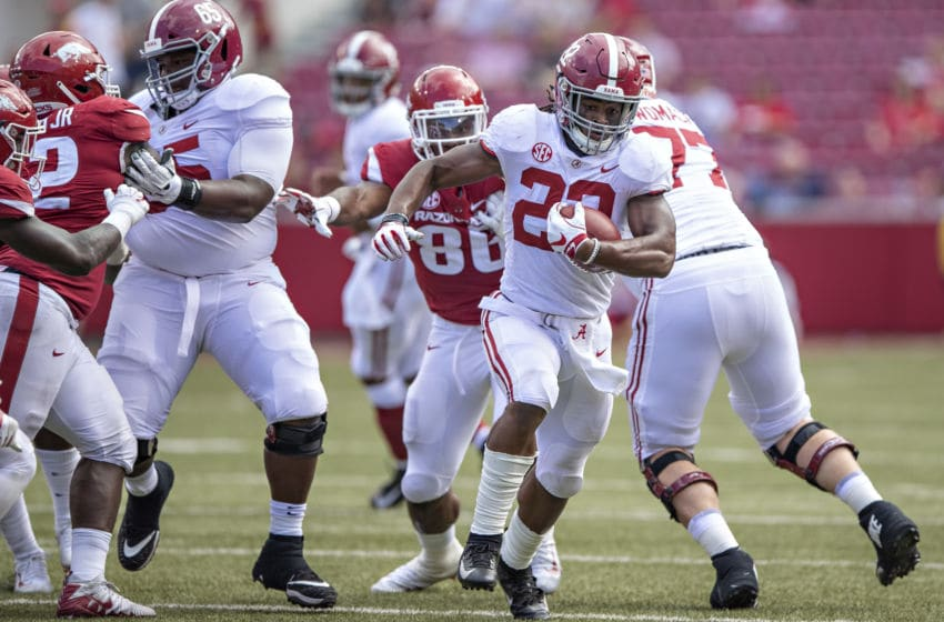 FAYETTEVILLE, AR - OCTOBER 6: Najee Harris #22 of the Alabama Crimson Tide runs the ball in the second half during a game against the Arkansas Razorbacks at Razorback Stadium on October 6, 2018 in Tuscaloosa, Alabamai. The Crimson Tide defeated the Razorbacks 65-31. (Photo by Wesley Hitt/Getty Images)