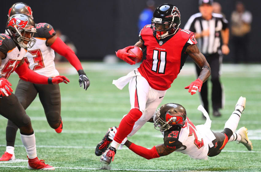 ATLANTA, GA - OCTOBER 14: Julio Jones #11 of the Atlanta Falcons is tackled by Ryan Smith #29 of the Tampa Bay Buccaneers during the first quarter against the Tampa Bay Buccaneers at Mercedes-Benz Stadium on October 14, 2018 in Atlanta, Georgia. (Photo by Scott Cunningham/Getty Images)