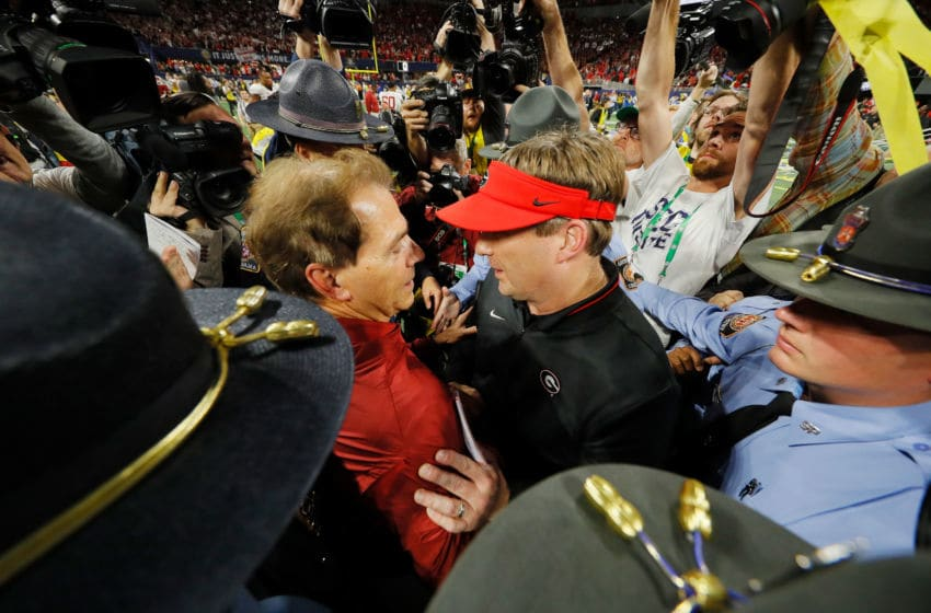 ATLANTA, GA - DECEMBER 01: Head coach Nick Saban of the Alabama Crimson Tide shakes hands with head coach Kirby Smart of the Georgia Bulldogs after the Alabama Crimson Tide defeated the Georgia Bulldogs 35-28 in the 2018 SEC Championship Game at Mercedes-Benz Stadium on December 1, 2018 in Atlanta, Georgia. (Photo by Kevin C. Cox/Getty Images)