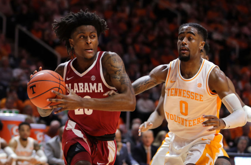 KNOXVILLE, TN - JANUARY 19: John Petty #23 of the Alabama Crimson Tide drives past Jordan Bone #0 of the Tennessee Volunteers during the first half of their game at Thompson-Boling Arena on January 19, 2019 in Knoxville, Tennessee. (Photo by Donald Page/Getty Images)