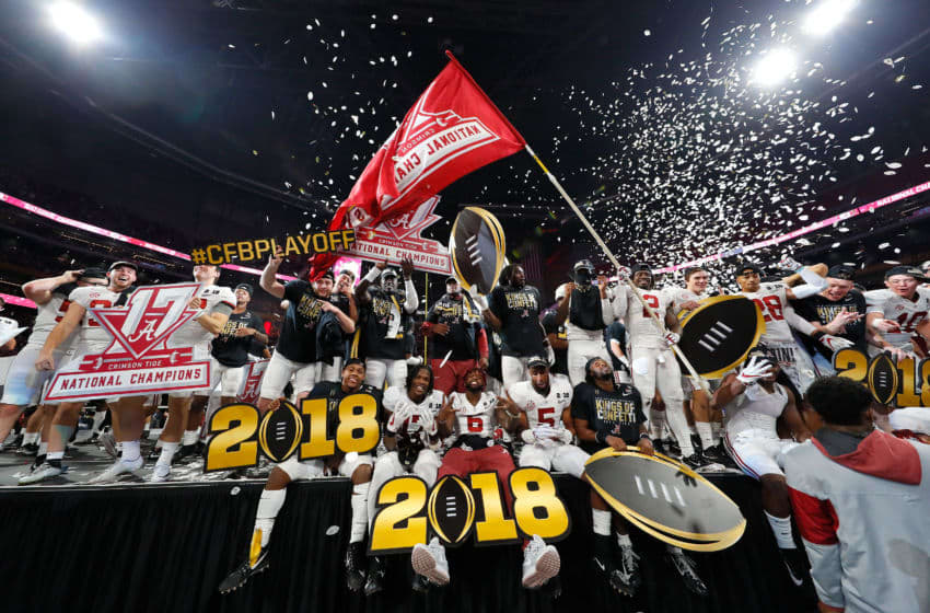 ATLANTA, GA - JANUARY 08: The Alabama Crimson Tide celebrates beating the Georgia Bulldogs in overtime and winning the CFP National Championship presented by AT