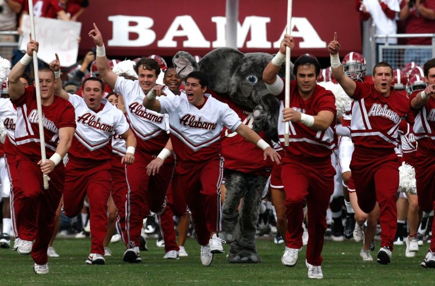 TUSCALOOSA, AL - OCTOBER 24: The cheerleaders of the Alabama Crimson Tide lead the team onto the field to face the Tennessee Volunteers at Bryant-Denny Stadium on October 24, 2009 in Tuscaloosa, Alabama. (Photo by Kevin C. Cox/Getty Images)