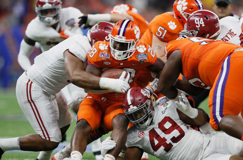 NEW ORLEANS, LA - JANUARY 01: Tavien Feaster #28 of the Clemson Tigers is tackled by Isaiah Buggs #49 of the Alabama Crimson Tide in the first quarter of the AllState Sugar Bowl at the Mercedes-Benz Superdome on January 1, 2018 in New Orleans, Louisiana. (Photo by Jamie Squire/Getty Images)
