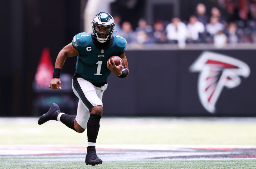 ATLANTA, GEORGIA - SEPTEMBER 12: Jalen Hurts #1 of the Philadelphia Eagles carries the ball during the first quarter against the Atlanta Falcons at Mercedes-Benz Stadium on September 12, 2021 in Atlanta, Georgia. (Photo by Todd Kirkland/Getty Images)