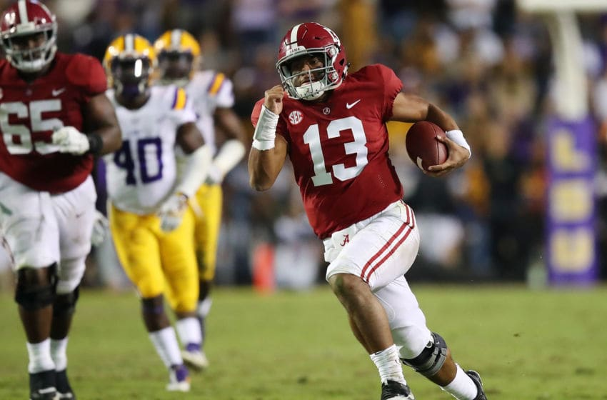 BATON ROUGE, LA - NOVEMBER 03: Tua Tagovailoa #13 of the Alabama Crimson Tide runs for a third quarter touchdown while playing the LSU Tigers at Tiger Stadium on November 3, 2018 in Baton Rouge, Louisiana. Alabama won the game 29-0. (Photo by Gregory Shamus/Getty Images)
