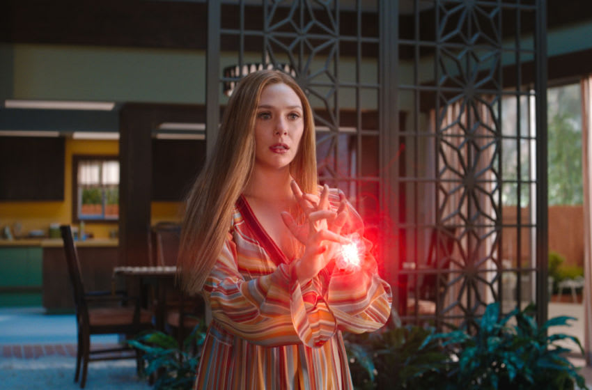 Elizabeth Olsen as Wanda Maximoff and Paul Bettany as Vision in Marvel Studios' WANDAVISION.  Photo courtesy of Marvel Studios.  © Marvel Studios 2021. All rights reserved.