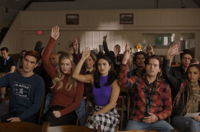 """Riverdale -- """"Chapter Eighty-One: The Homecoming"""" -- Image Number: RVD505fg_0041r -- Pictured (L-R): KJ Apa as Archie Andrews, Lili Reinhart as Betty Cooper, Camila Mendes as Veronica Lodge, Cole Sprouse as Jughead Jones, Vanessa Morgan as Toni Topaz, Marion Eisman as Doris Bell, Peter Bryant as Mr. Weatherbee, Drew Ray Tanner as Fangs Fogarty and Jordan Connor as Sweet Pea -- Photo: The CW -- © 2020 The CW Network, LLC. All Rights Reserved."""