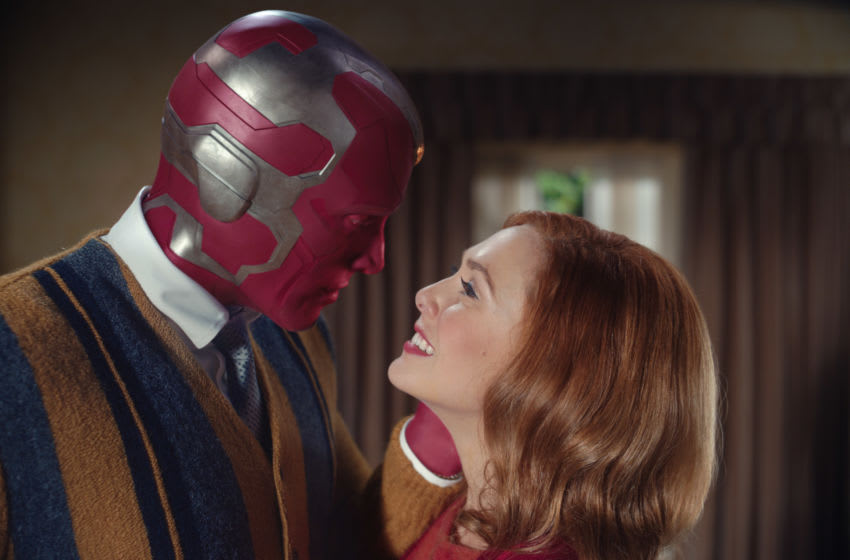 Paul Bettany as Vision and Elizabeth Olsen as Wanda Maximoff in Marvel Studios' WANDAVISION. Photo courtesy of Marvel Studios. ©Marvel Studios. All Rights Reserved.