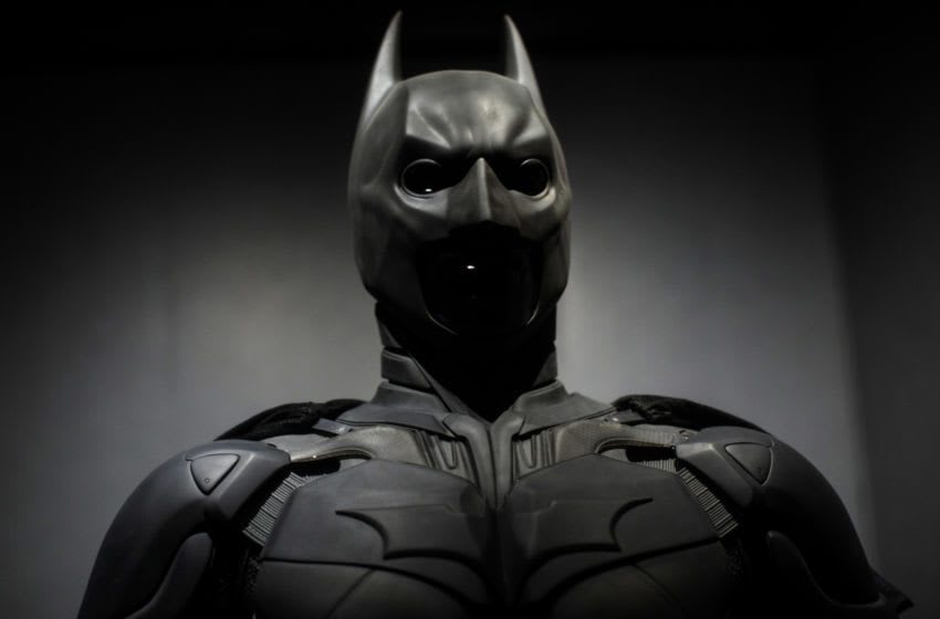 LONDON, ENGLAND - FEBRUARY 22: A Batman costume from the 2012 Dark Knight Rises film worn by Christian Bale and designed by Lindy Hemming is on display at the DC Comics Exhibition: Dawn Of Super Heroes at the O2 Arena on February 22, 2018 in London, England. The exhibition, which opens on February 23rd, features 45 original costumes, models and props used in DC Comics productions including the Batman, Wonder Woman and Superman films. (Photo by Jack Taylor/Getty Images)