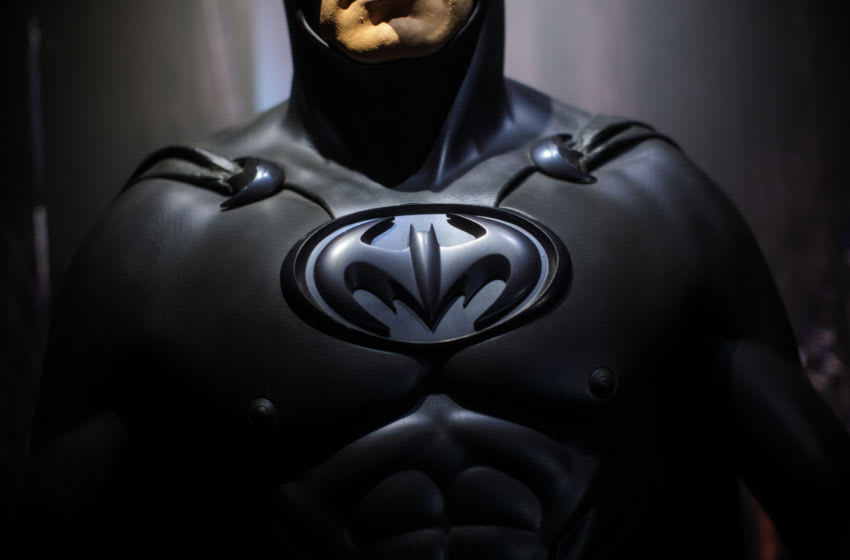 LONDON, ENGLAND - FEBRUARY 22: A Batman costume from the 1997 Batman & Robin film worn by George Clooney and designed by Rob Ringwood and Mary Vogt is on display at the DC Comics Exhibition: Dawn Of Super Heroes at the O2 Arena on February 22, 2018 in London, England. The exhibition, which opens on February 23rd, features 45 original costumes, models and props used in DC Comics productions including the Batman, Wonder Woman and Superman films. (Photo by Jack Taylor/Getty Images)