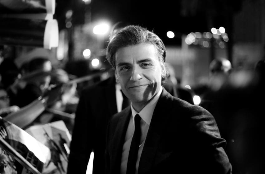 HOLLYWOOD, CALIFORNIA - DECEMBER 16: (EDITORS NOTE: Image has been converted to black and white.) Oscar Isaac attends the Premiere of Disney's