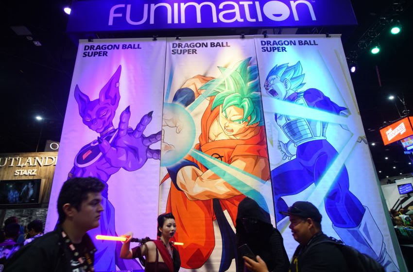SAN DIEGO, CA - JULY 20: Attendees walk in front of the Funimation boothd at the San Diego Convention Center during Comic Con International on July 20, 2017 in San Diego, California. Comic Con International is North America's largest Comic convention featuring pop culture and entertainment elements across virtually all genres, including horror, animation, anime, manga, toys, collectible card games, video games, webcomics, and fantasy novels as well as movie premieres and actor panels.(Photo by Sandy Huffaker/Getty Images)