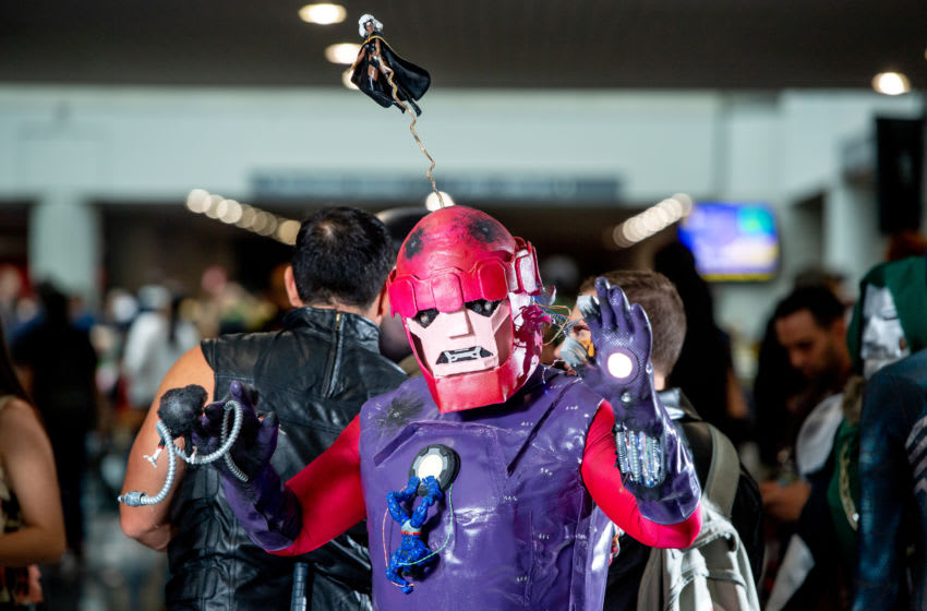A fan cosplays as a Sentinel from X-Men (Photo by Roy Rochlin/Getty Images)