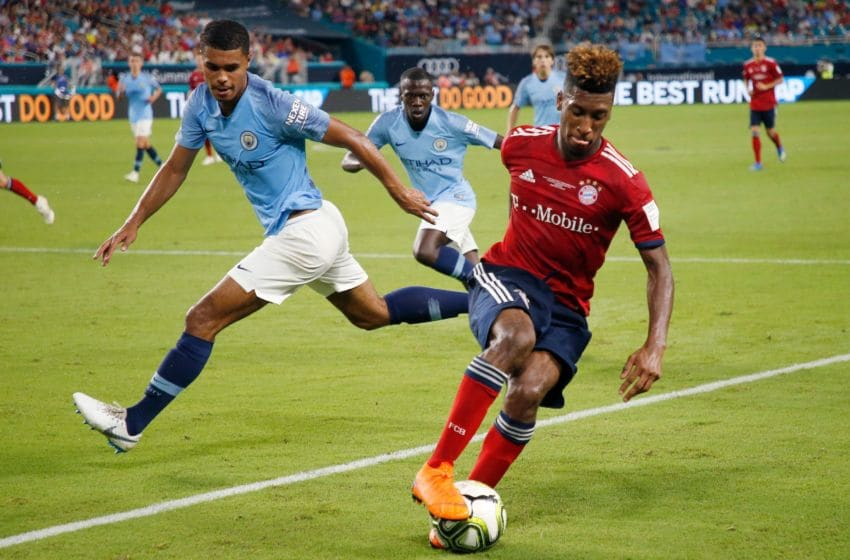 Bayern Munich's Kingsley Coman (R) controls the ball next to Manchester City's Cameron Humphreys during the International Champions Cup friendly match between FC Bayern Munich and Manchester City at Hard Rock Stadium in Miami, Florida, on July 28, 2018. (Photo by RHONA WISE / AFP) (Photo credit should read RHONA WISE/AFP via Getty Images)