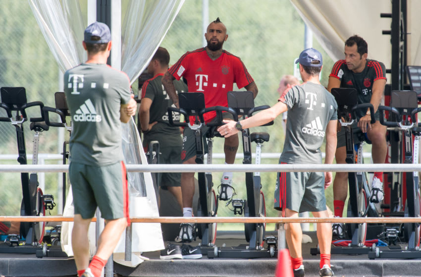 03 August 2018, Germany, Rottach-Egern: Arturo Vidal and sports director Hasan Salihamidzic from FC Bayern Munich sitting on ergometers. The club is located for a one-week training camp at Tegernsee. Photo: Peter Kneffel/dpa (Photo by Peter Kneffel/picture alliance via Getty Images)