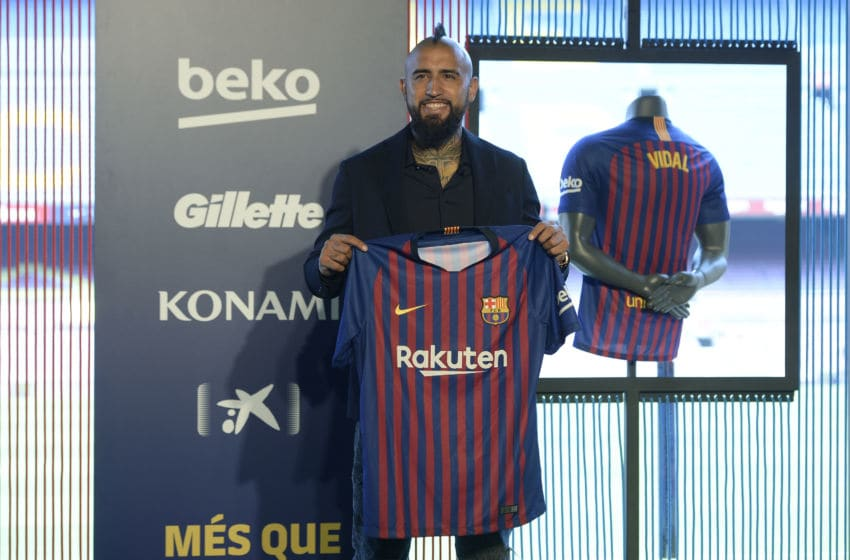 Barcelona's new player Chilean midfielder Arturo Vidal poses during his official presentation at the Camp Nou stadium in Barcelona on August 6, 2018. (Photo by Josep LAGO / AFP) (Photo credit should read JOSEP LAGO/AFP/Getty Images)