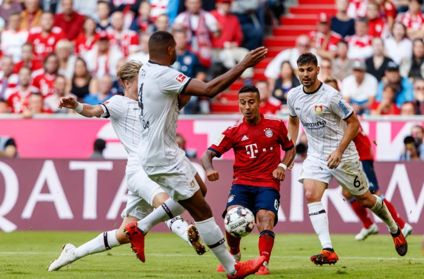 MUNICH, GERMANY - SEPTEMBER 15: Thiago Alcantara of Bayern Muenchen and Tin Jedvaj of Leverkusen battle for the ball during the Bundesliga match between FC Bayern Muenchen and Bayer 04 Leverkusen on September 15, 2018 in Munich, Germany. (Photo by TF-Images/Getty Images)