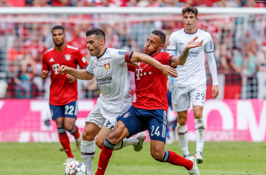 MUNICH, GERMANY - SEPTEMBER 15: Kevin Volland of Leverkusen and Corentin Tolisso of Bayern Muenchen battle for the ball during the Bundesliga match between FC Bayern Muenchen and Bayer 04 Leverkusen on September 15, 2018 in Munich, Germany. (Photo by TF-Images/Getty Images)