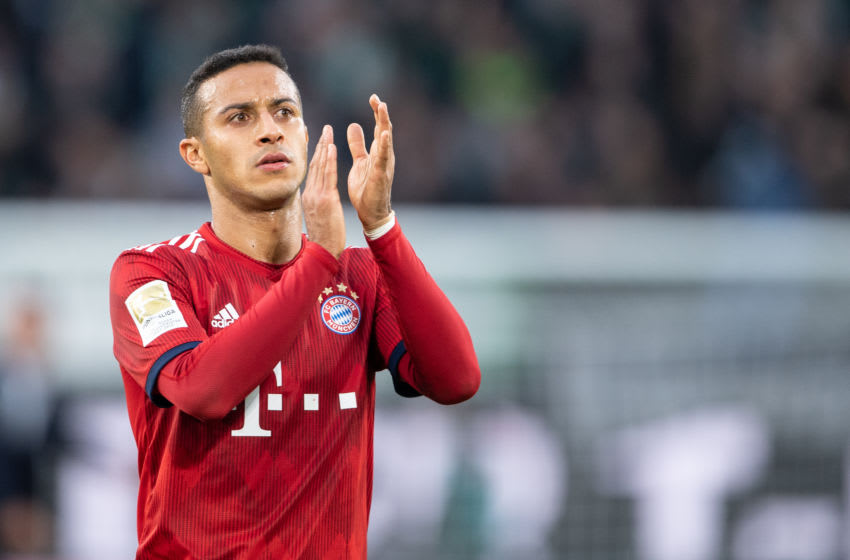 20 October 2018, Lower Saxony, Wolfsburg: 20 October 2018, Germany, Wolfsburg:Soccer: Bundesliga, 8th matchday, VfL Wolfsburg - FC Bayern Munich in the Volkswagen Arena. Munich's Thiago applauds after the game. Photo: Swen Pförtner/dpa - IMPORTANT NOTICE: DFL an d DFB regulations prohibit any use of photographs as image sequences and/or quasi-video. (Photo by Swen Pförtner/picture alliance via Getty Images)
