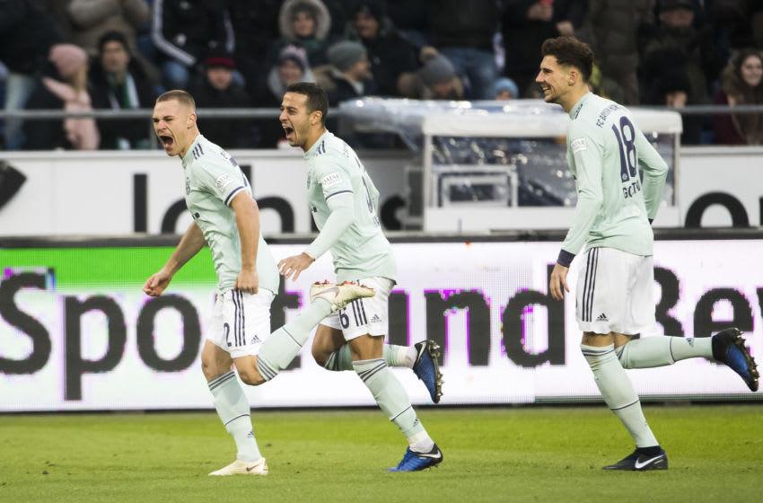 Joshua Kimmich, Thiago Alcantara, and Leon Goretzka, Bayern Munich. (Photo credit should read ODD ANDERSEN/AFP via Getty Images)