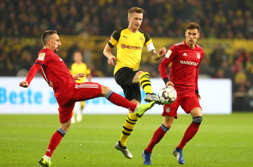 DORTMUND, GERMANY - NOVEMBER 10: Franck Ribery of Bayern Muenchen, Marco Reus of Borussia Dortmund and Leon Goretzka of Bayern Muenchen battle for the ball during the Bundesliga match between Borussia Dortmund and Bayern Muenchen at Signal Iduna Park on November 10, 2018 in Dortmund, Germany. (Photo by TF-Images/TF-Images via Getty Images)