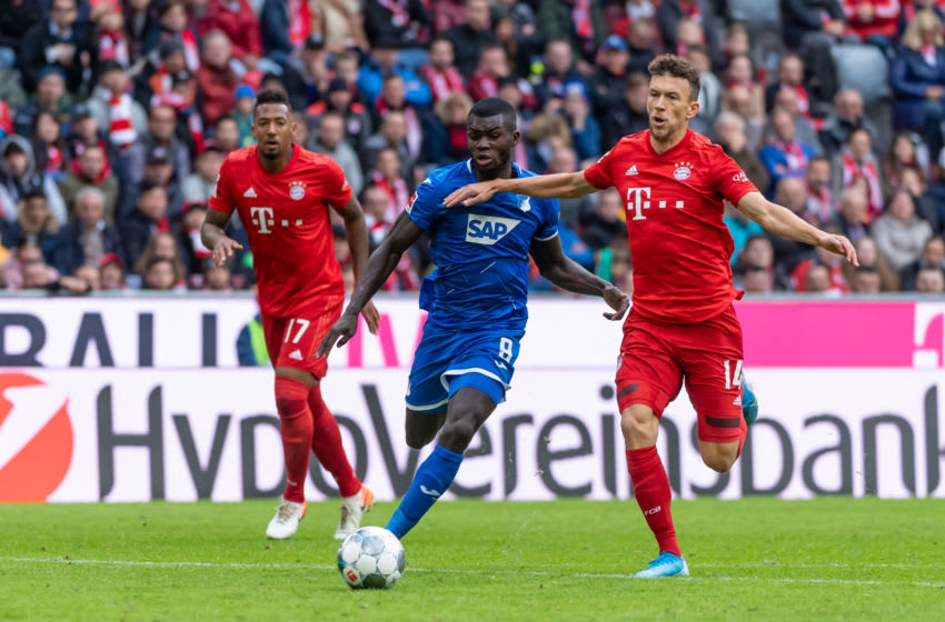 MUNICH, GERMANY - OCTOBER 05: Jerome Boateng of FC Bayern Muenchen, Ihlas Bebou of TSG 1899 Hoffenheim and Ivan Perisic of FC Bayern Muenchen battle for the ball during the Bundesliga match between FC Bayern Muenchen and TSG 1899 Hoffenheim at Allianz Arena on October 5, 2019 in Munich, Germany. (Photo by TF-Images/Getty Images)