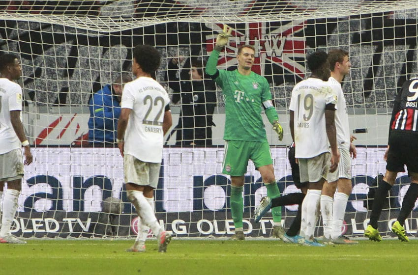 Bayern Munich's German goalkeeper Manuel Neuer (C) and his teammates react after Frankfurt scored the 4-1 during the German first division Bundesliga football match between Eintracht Frankfurt and FC Bayern Munich on November 2, 2019 in Frankfurt am Main, western Germany. (Photo by Daniel ROLAND / AFP) / DFL REGULATIONS PROHIBIT ANY USE OF PHOTOGRAPHS AS IMAGE SEQUENCES AND/OR QUASI-VIDEO (Photo by DANIEL ROLAND/AFP via Getty Images)