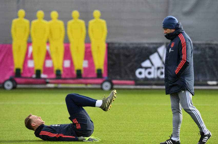 Bayern Munich's goalkeeper Manuel Neuer (L) warms up next to Bayern Munich's coach Hansi Flick (R) during the training session on the eve of the UEFA Champions League Group B football match between FC Bayern Munich and Tottenham Hotspur at the clubs training ground in Munich, southern Germany, on December 10, 2019. (Photo by Christof STACHE / AFP) (Photo by CHRISTOF STACHE/AFP via Getty Images)