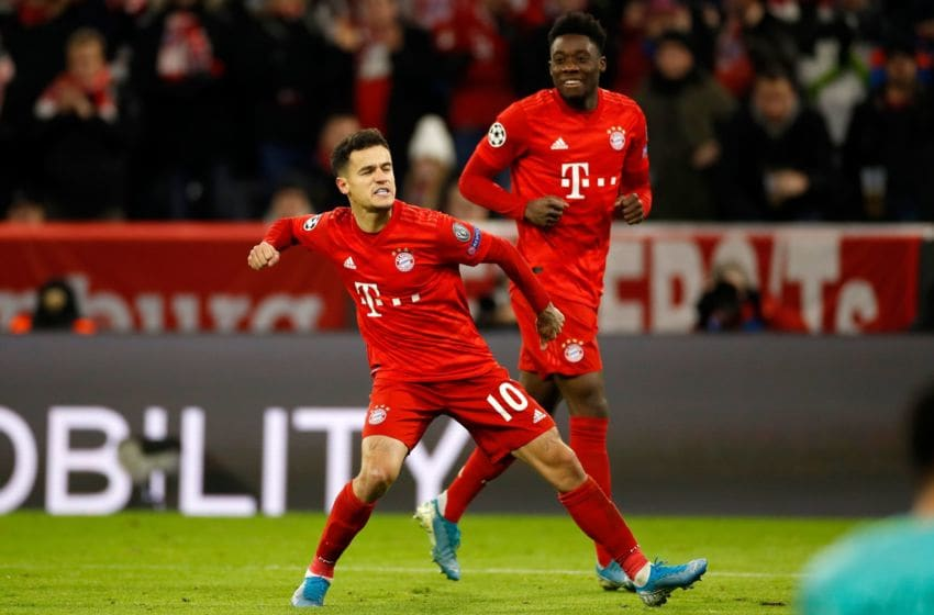 Bayern Munich's Brazilian midfielder Philippe Coutinho (L) celebrates after he scored a goal next to Bayern Munich's Canadian midfielder Alphonso Davies during the UEFA Champions League Group B football match between Bayern Munich and Tottenham FC on December 11, 2019 in Munich, Germany. (Photo by Odd ANDERSEN / AFP) (Photo by ODD ANDERSEN/AFP via Getty Images)