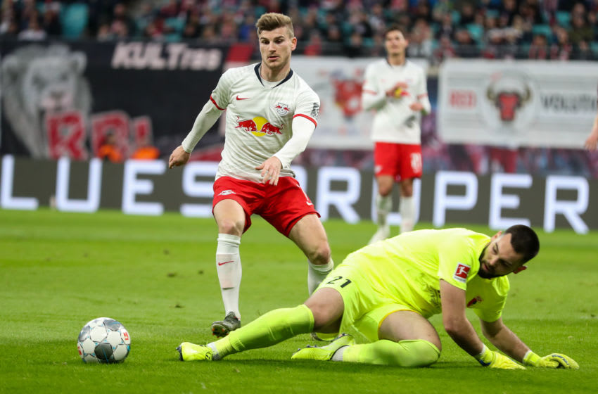 21 December 2019, Saxony, Leipzig: Football: Bundesliga, 17th matchday, RB Leipzig - FC Augsburg in the Red Bull Arena. Augsburg goalkeeper Tomas Koubek (r) misses against Leipzig's Timo Werner. Photo: Jan Woitas/dpa-Zentralbild/dpa - IMPORTANT NOTE: In accordance with the regulations of the DFL Deutsche Fußball Liga and the DFB Deutscher Fußball-Bund, it is prohibited to exploit or have exploited in the stadium and/or from the game taken photographs in the form of sequence images and/or video-like photo series. (Photo by Jan Woitas/picture alliance via Getty Images)