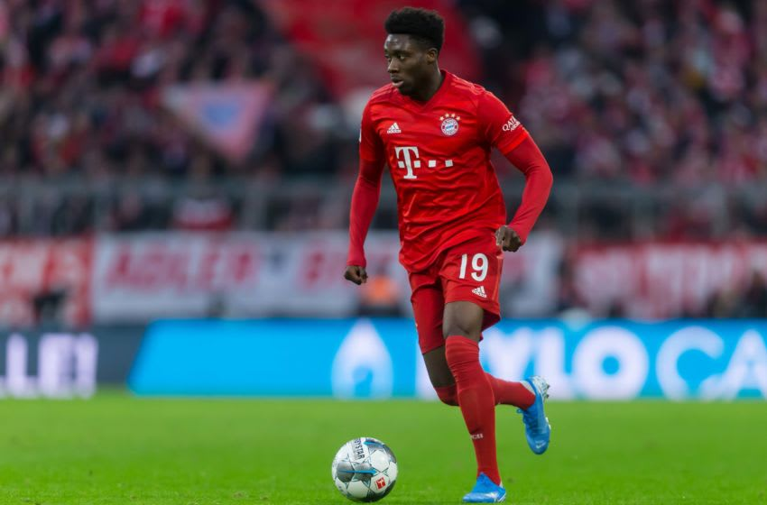 MUNICH, GERMANY - DECEMBER 21: (BILD ZEITUNG OUT) Alphonso Davies of FC Bayern Muenchen controls the ball during the Bundesliga match between FC Bayern Muenchen and VfL Wolfsburg at Allianz Arena on December 21, 2019 in Munich, Germany. (Photo by TF-Images/Getty Images)