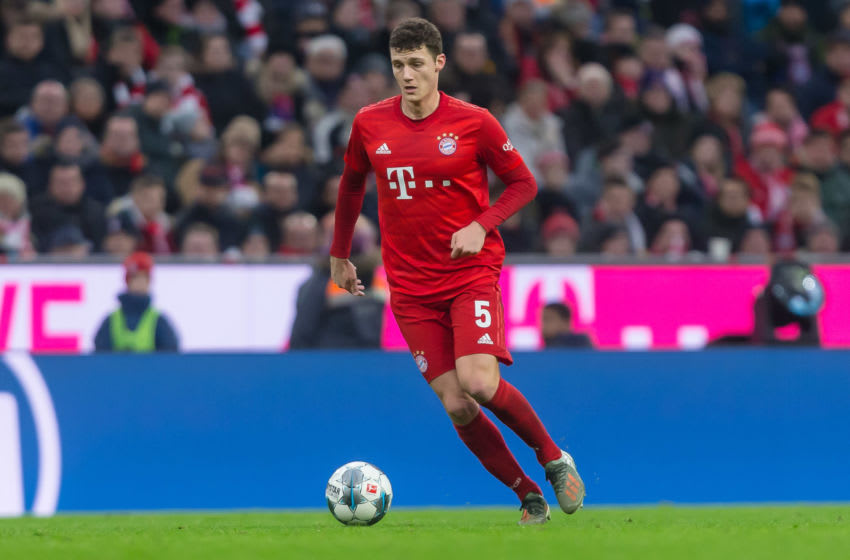 MUNICH, GERMANY - DECEMBER 21: (BILD ZEITUNG OUT) Benjamin Pavard of FC Bayern Muenchen controls the ball during the Bundesliga match between FC Bayern Muenchen and VfL Wolfsburg at Allianz Arena on December 21, 2019 in Munich, Germany. (Photo by TF-Images/Getty Images)