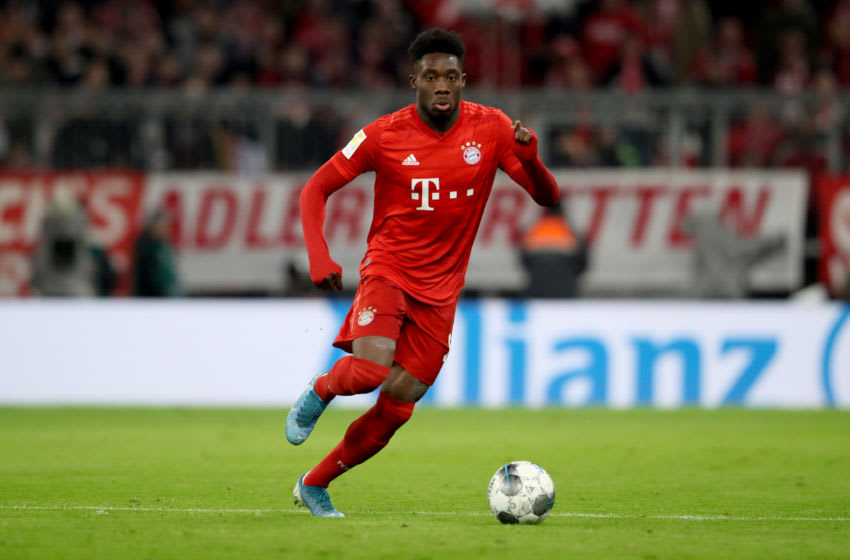 MUNICH, GERMANY - NOVEMBER 30: Alphonso Davies of FC Bayern Muenchen runs with the ball during the Bundesliga match between FC Bayern Muenchen and Bayer 04 Leverkusen at Allianz Arena on November 30, 2019 in Munich, Germany. (Photo by A. Hassenstein/Getty Images for FC Bayern)