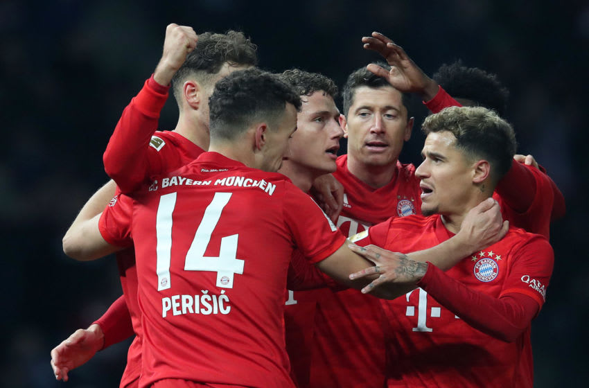 Bayern Munich's players, including Polish forward Robert Lewandowski (2ndR) and Brazilian midfielder Philippe Coutinho (R) celebrate their opening goal during the German first division Bundesliga football match Hertha Berlin v Bayern Munich in Berlin, on January 19, 2020. (Photo by RONNY HARTMANN / AFP) / DFL REGULATIONS PROHIBIT ANY USE OF PHOTOGRAPHS AS IMAGE SEQUENCES AND/OR QUASI-VIDEO (Photo by RONNY HARTMANN/AFP via Getty Images)