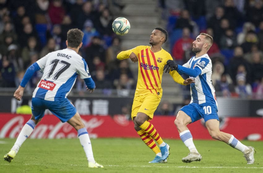 BARCELONA, SPAIN - January 04: Nelson Semedo #2 of Barcelona challenged by Sergi Darder #10 of Espanyol and Didac #17 of Espanyol during the Espanyol V Barcelona, La Liga regular season match at RCDE Stadium on January 4th 2020 in Barcelona, Spain. (Photo by Tim Clayton/Corbis via Getty Images)