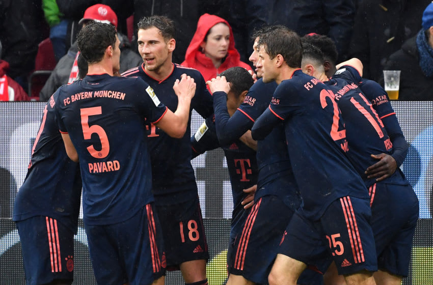 01 February 2020, Rhineland-Palatinate, Mainz: Football: Bundesliga, FSV Mainz 05 - Bayern Munich, 20th matchday. Bavaria's Thiago (M) cheers with his teammates after his goal for the 0:3. Photo: Torsten Silz/dpa - IMPORTANT NOTE: In accordance with the regulations of the DFL Deutsche Fußball Liga and the DFB Deutscher Fußball-Bund, it is prohibited to exploit or have exploited in the stadium and/or from the game taken photographs in the form of sequence images and/or video-like photo series. (Photo by Torsten Silz/picture alliance via Getty Images)