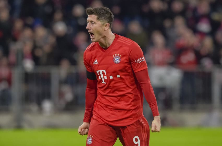 Bayern Munich's Polish forward Robert Lewandowski celebrates scoring during the German first division Bundesliga football match FC Bayern Munich v SC Paderborn in Munich, southern Germany, on February 21, 2020. (Photo by Guenter SCHIFFMANN / AFP) / RESTRICTIONS: DFL REGULATIONS PROHIBIT ANY USE OF PHOTOGRAPHS AS IMAGE SEQUENCES AND/OR QUASI-VIDEO (Photo by GUENTER SCHIFFMANN/AFP via Getty Images)