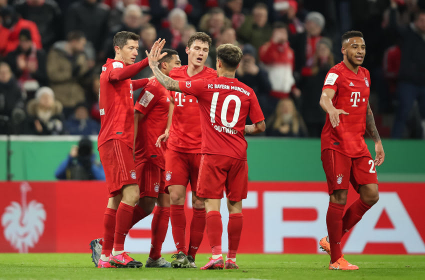 MUNICH, GERMANY - FEBRUARY 05: Robert Lewandowski of FC Bayern Muenchen celebrates after scoring his team`s third goal with teammates during the DFB Cup round of sixteen match between FC Bayern Muenchen and TSG 1899 Hoffenheim at Allianz Arena on February 5, 2020 in Munich, Germany. (Photo by Christian Kaspar-Bartke/Bongarts/Getty Images)