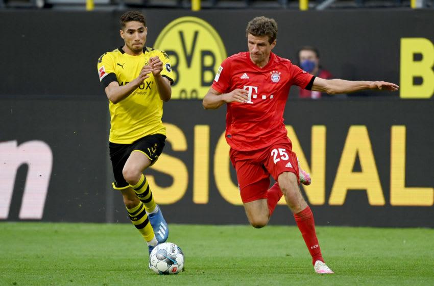 Achraf Hakimi, Borussia Dortmund and Thomas Muller, Bayern Munich. (Photo by Federico Gambarini/Pool via Getty Images)