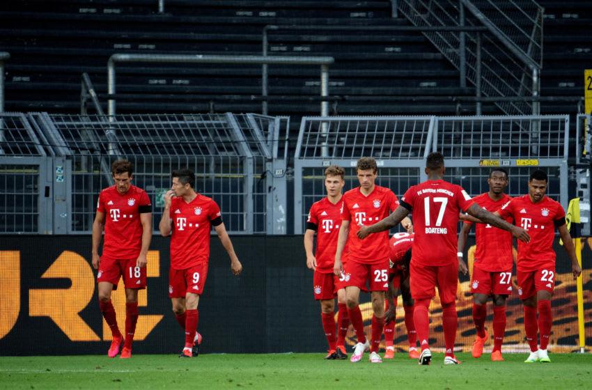 Bayern Munich players celebrating against Borussia Dortmund. (Photo by Federico Gambarini/Pool via Getty Images)