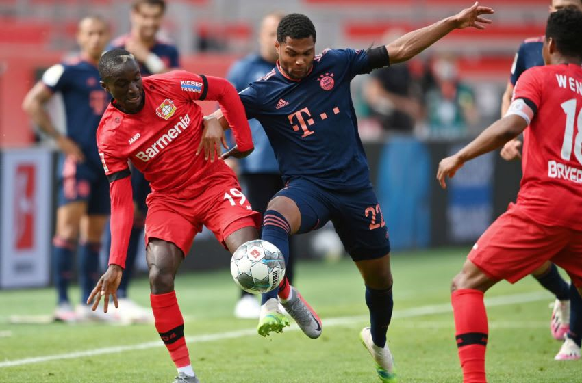 Serge Gnabry, Bayern Munich and Moussa Diaby, Bayer Leverkusen. (Photo by MATTHIAS HANGST/POOL/AFP via Getty Images)