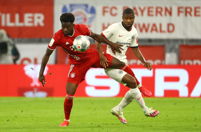 Alphonso Davies, Bayern Munich and  Almamy Toure, Eintracht Frankfurt. (Photo by KAI PFAFFENBACH/POOL/AFP via Getty Images)
